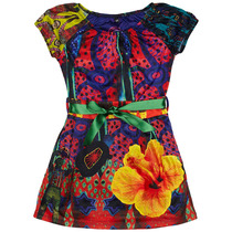 Melon - Short sleeve dress in reds and blues with a yellow hibiscus - Cirque du Soleil