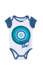 Bolix white short sleeve romper with blue trim and circle graphic detail in turquoise, green and navy.